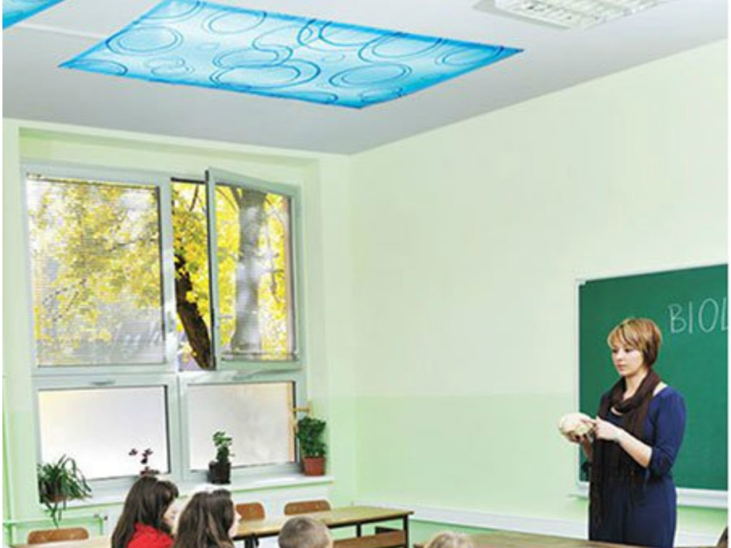 teacher in classroom with kids and pattern light