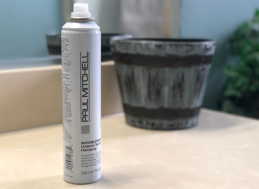 paul mitchell hairspray sitting on countertop