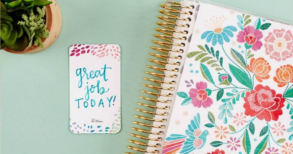 Erin Condren Compliment Card next to journal