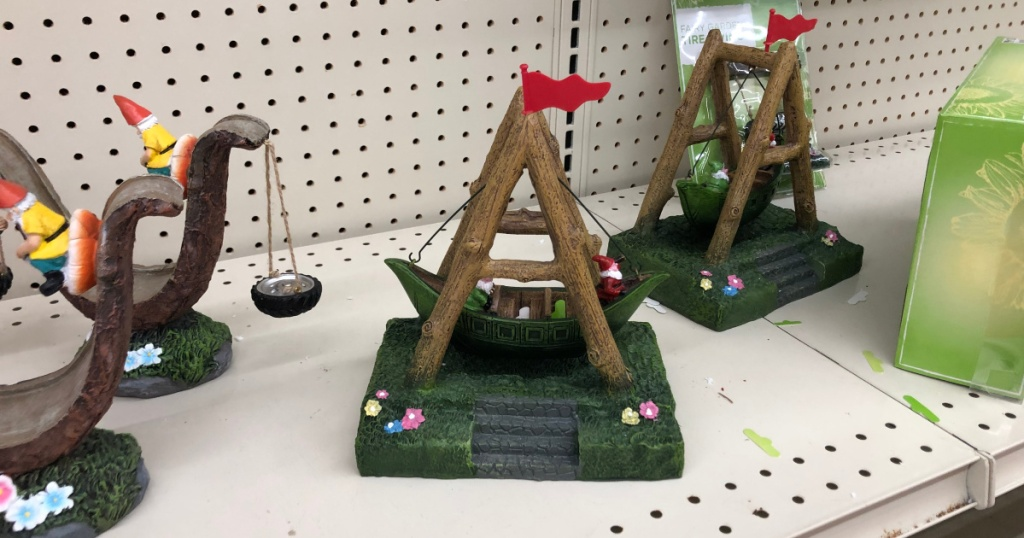 fairy garden gnome on boat swing on shelf at store