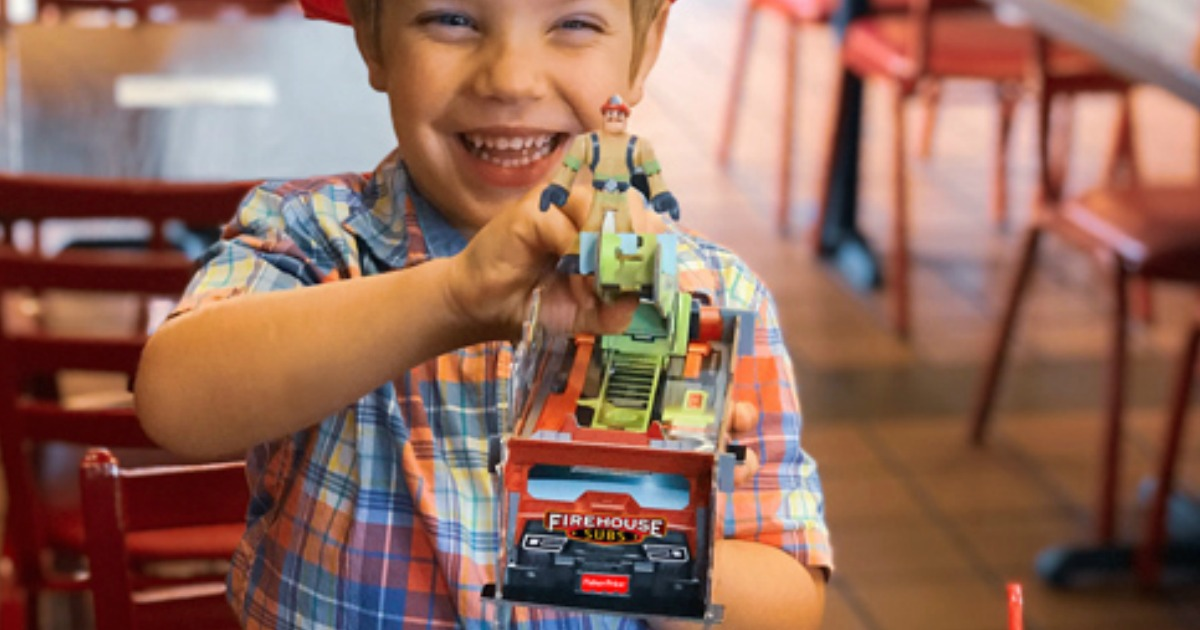Child playing with Rescue Heroes build-able fire truck in Firehouse Subs restaurant