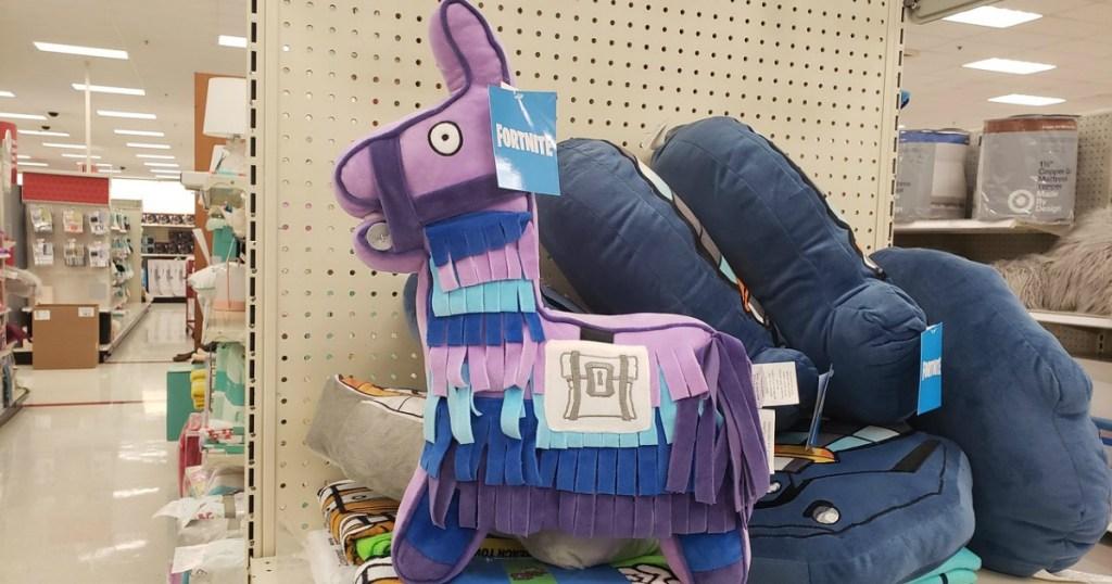 purple and blue pinata llama plush in-store