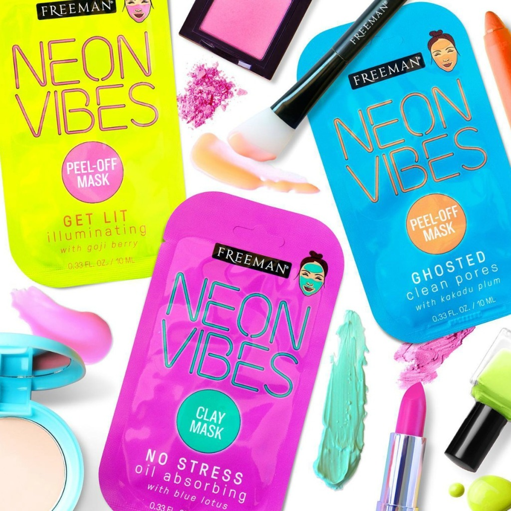 Freeman Beauty neon colored facial masks with neon colored beauty products and makeup