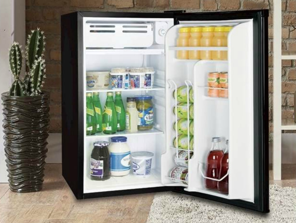 black mini fridge with open door and displayed contents