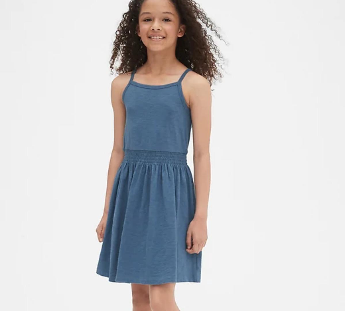 Girl wearing denim Gap dress