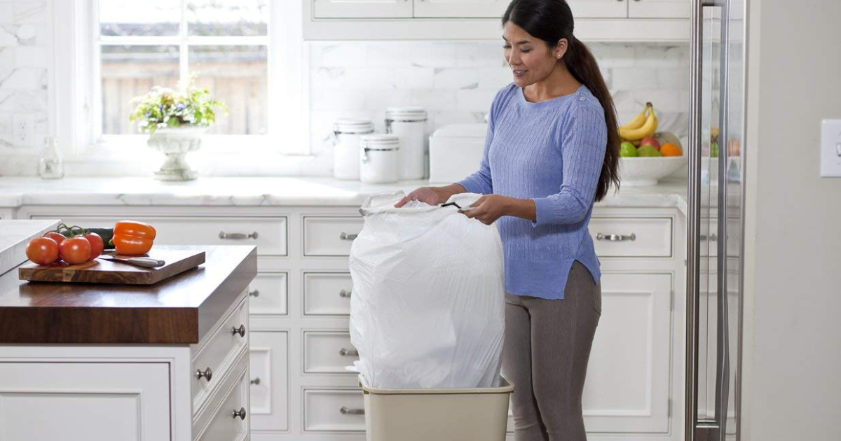 Woman holding Glad Trash Bag