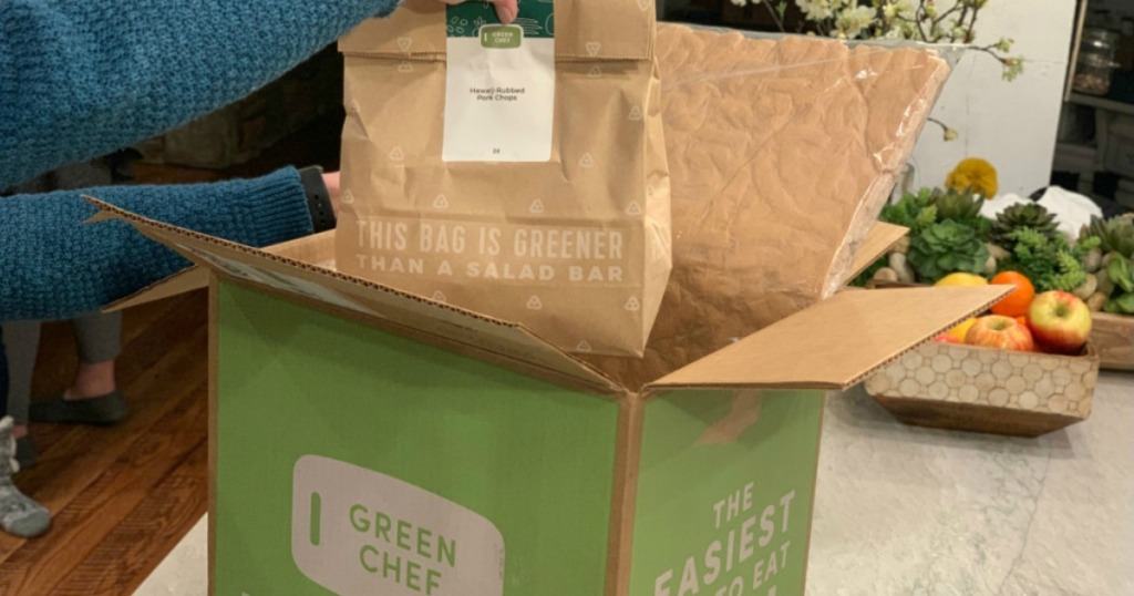 hand pulling meal bag out of Green Chef Box