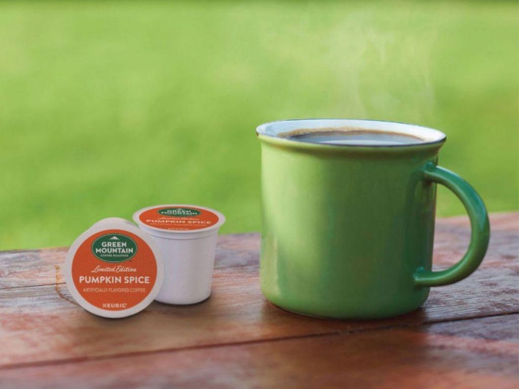 Green Mountain Coffee Pumpkin Spice K-Cups with green coffee mug outside