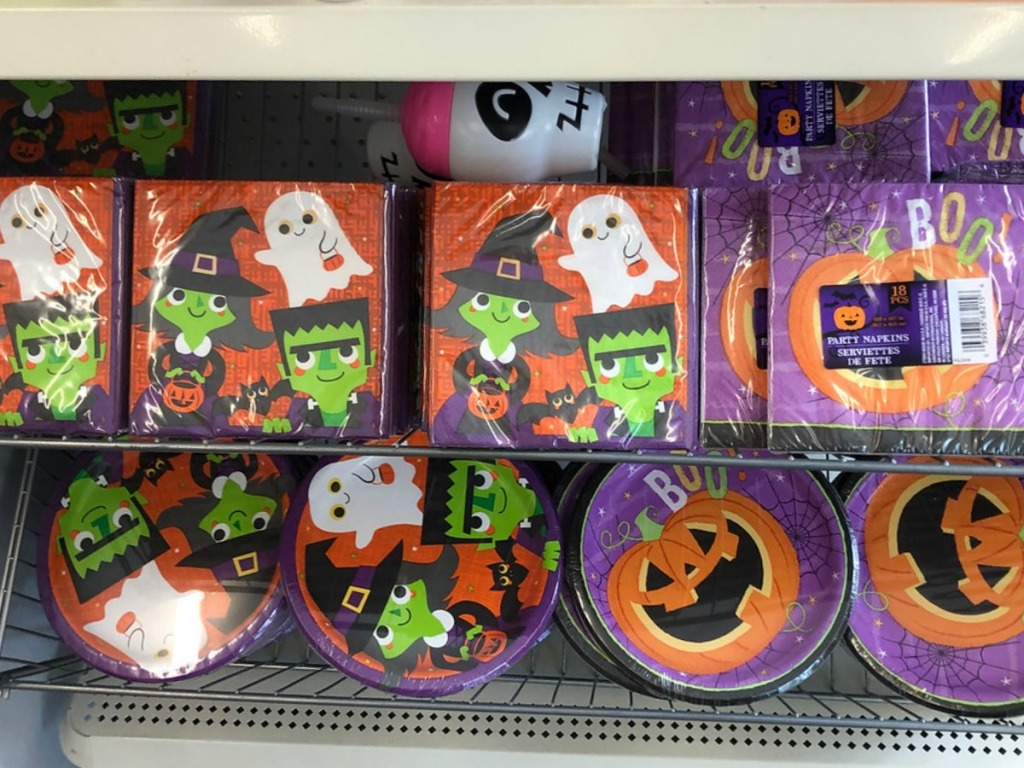 plates and napkins in store with pumpkins and witches on them