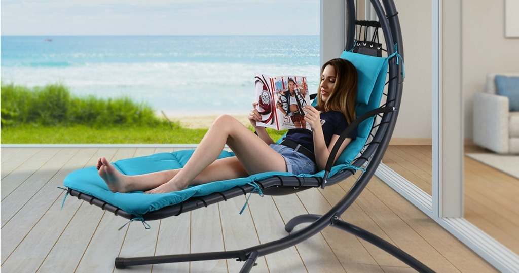 woman relaxing in Hanging Rocking Sunshade Canopy Lounger in Mint