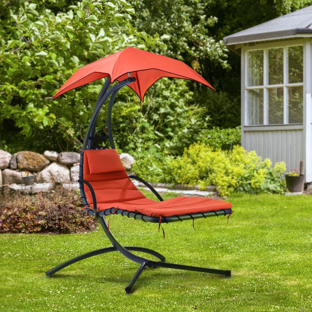 Red Hanging Sunshade Chair in back yard