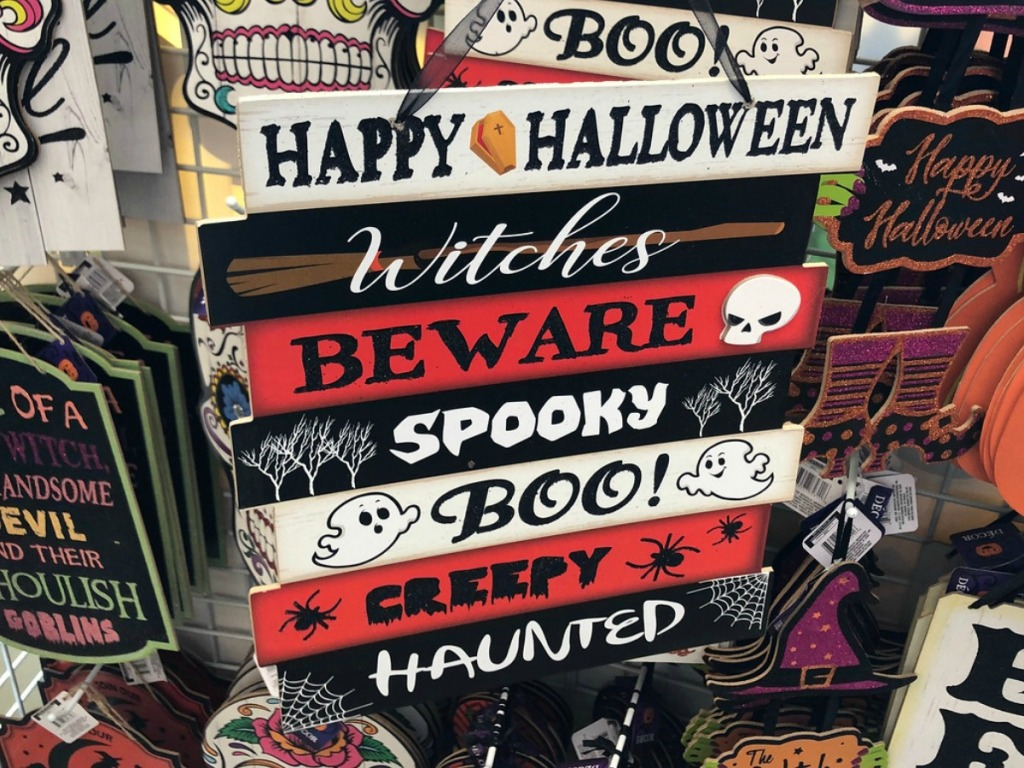 sign with halloween welcome on it