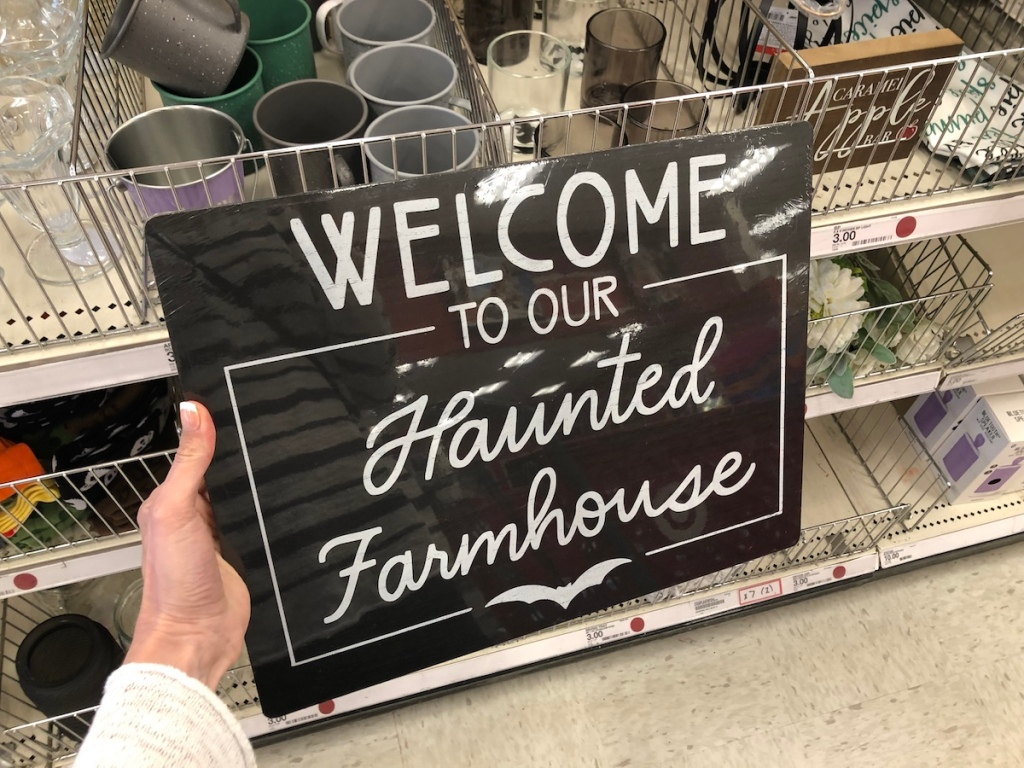 hand holding Haunted Farmhouse Tray