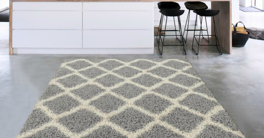 Gray and White Area Rug on gray kitchen floor near counter with black stools