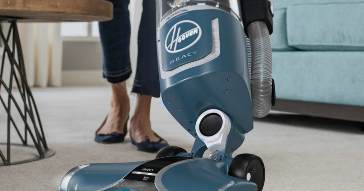 woman using a Hoover REACT vacuum to clean the rug