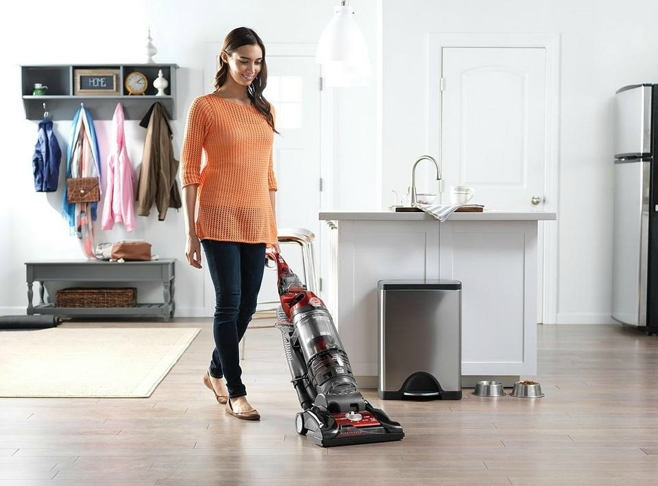 Woman vacuuming with the Hoover Windtunnel 3 Pro Vacuum