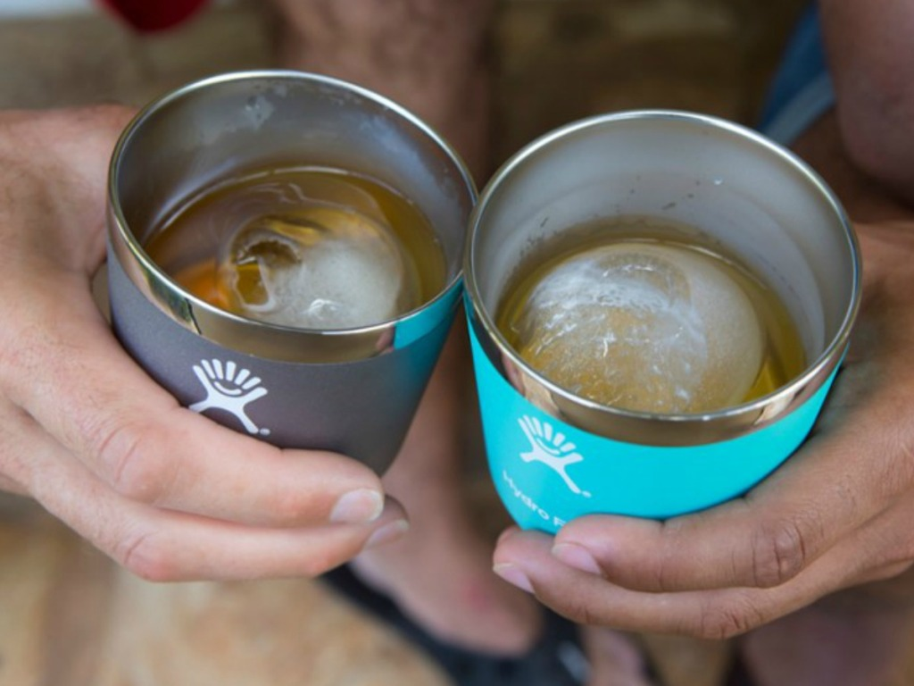 hands holding short hydro flask tumblers