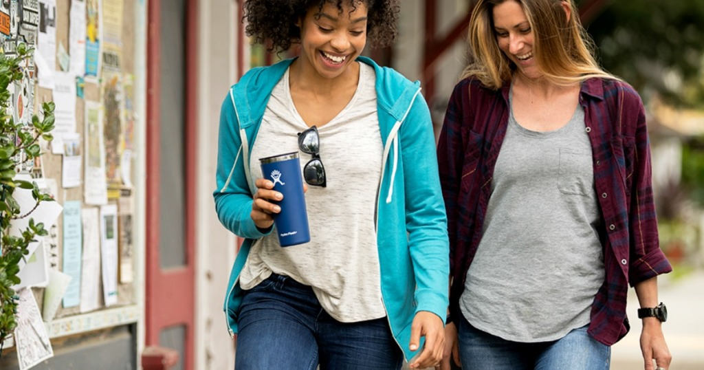Women walking and holding Hydro Flask Tumbler