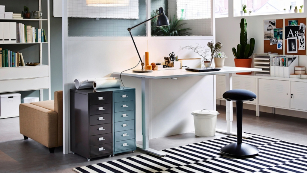 white ikea desk in office with light and stool