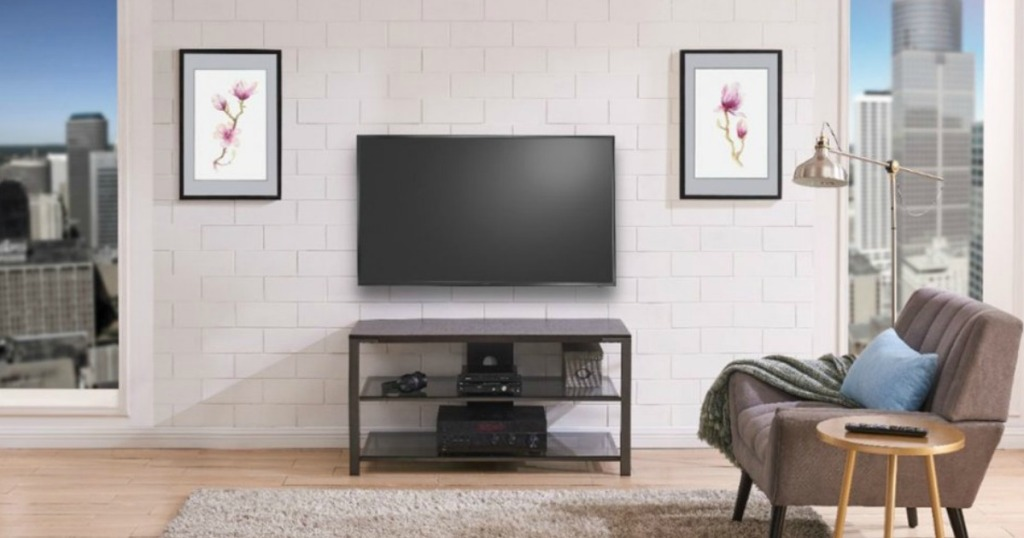 living room with tv stand and tv