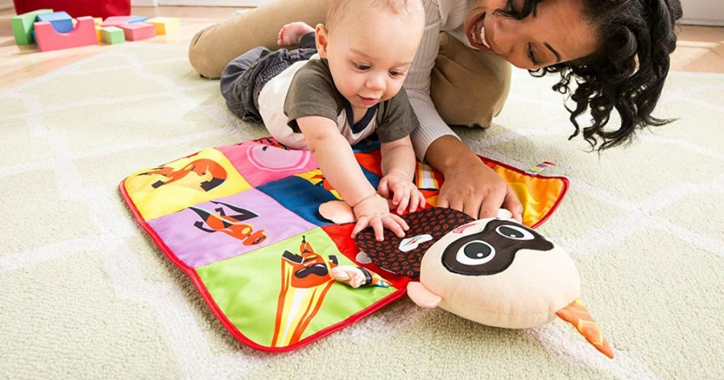 Mom and child playing with jack jack play mat