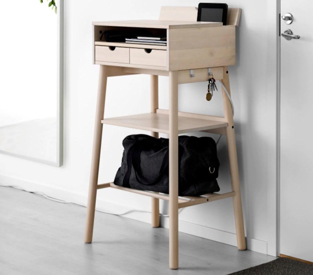 IEKA standing desk against wall