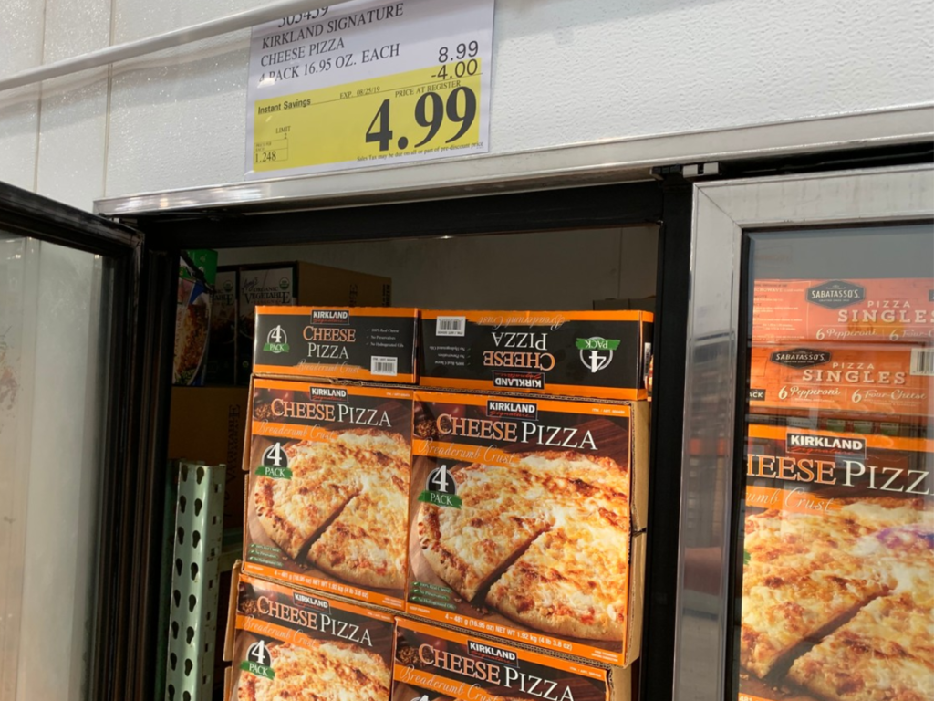 Kirkland Signature Cheese Pizza 4-Pack in Costco with sale sign