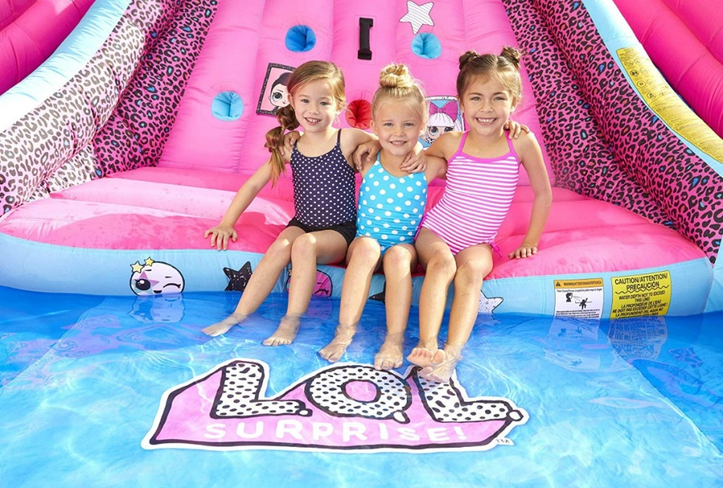 L.O.L. Surprise Inflatable River Race Water Slide pool area with three kids