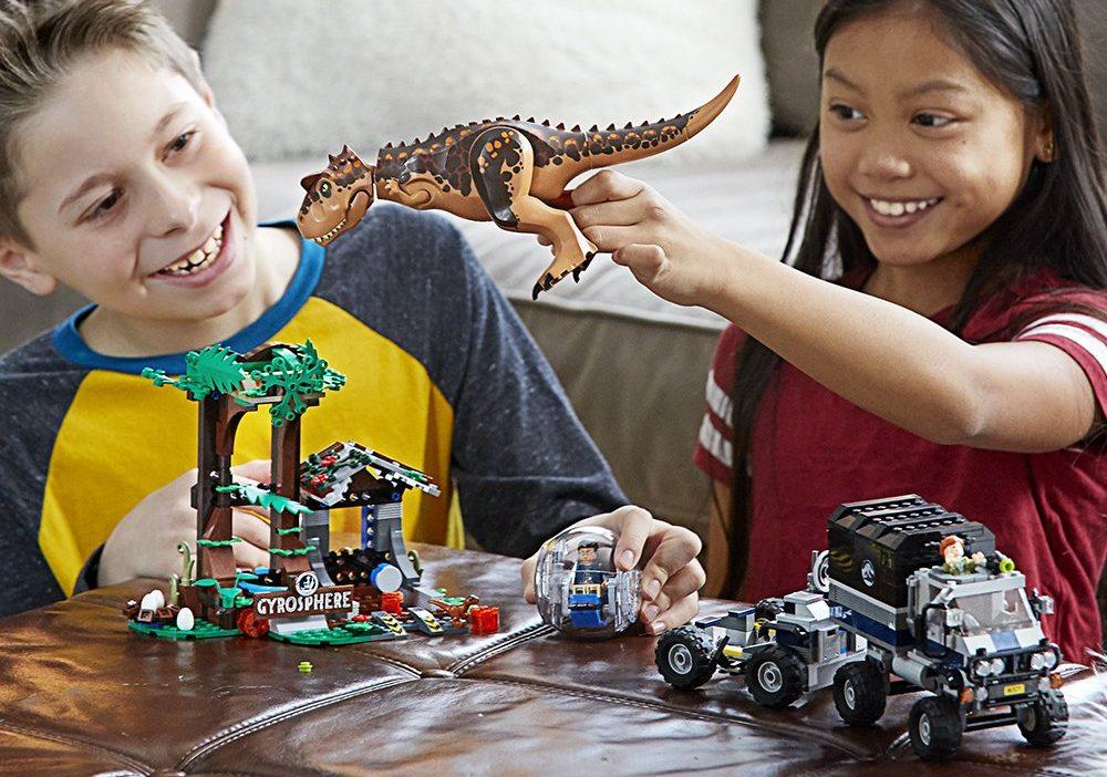 kids playing with LEGO Jurassic World Carnotaurus Gyrosphere Escape set