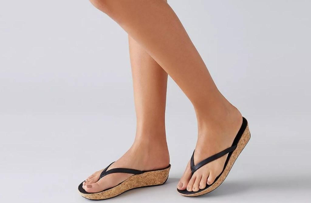 woman wearing brown sandals