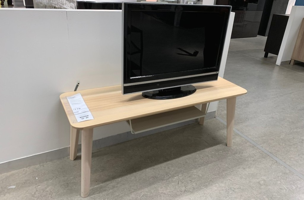 wood TV stand in ikea store