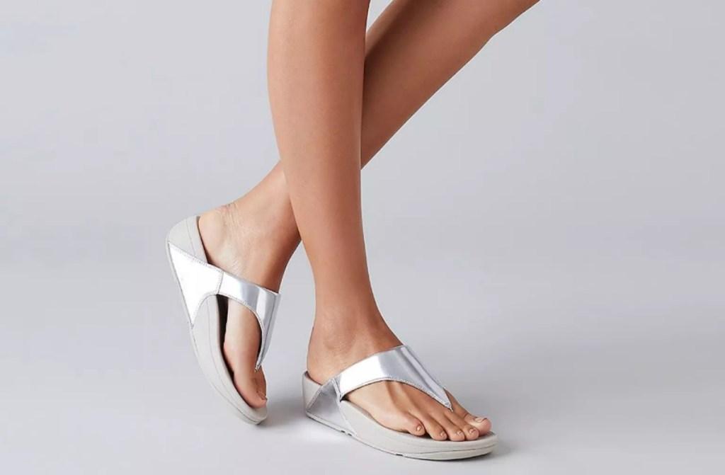 woman wearing silver sandals