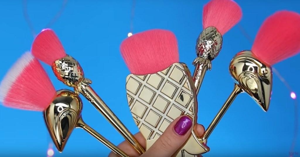 Woman holding Let's Flamingle Brush Set