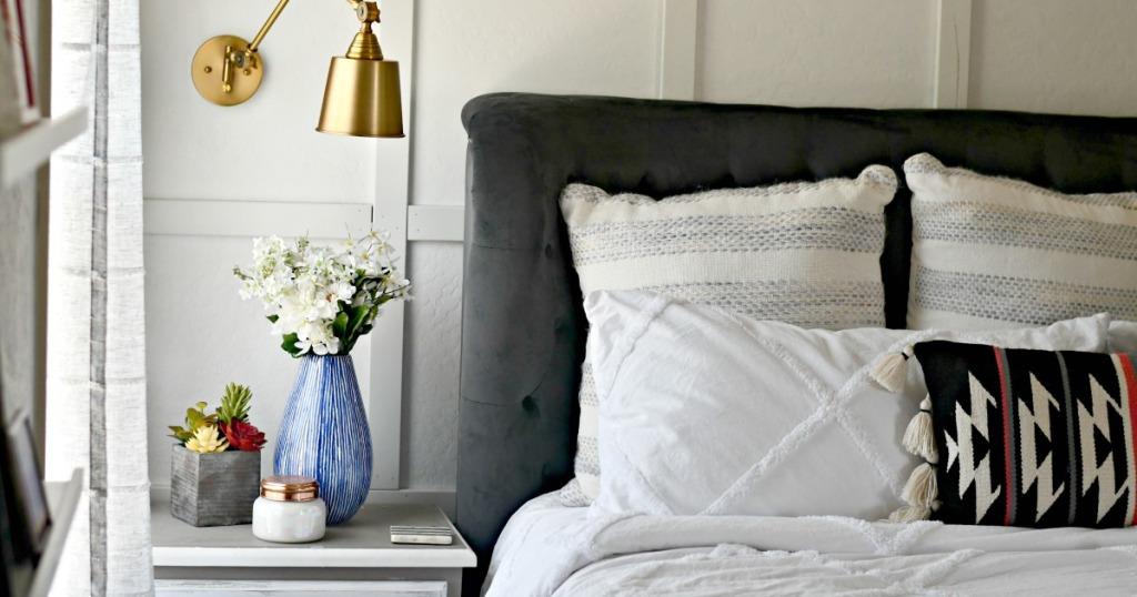bedroom with nightstand and pillows on bed