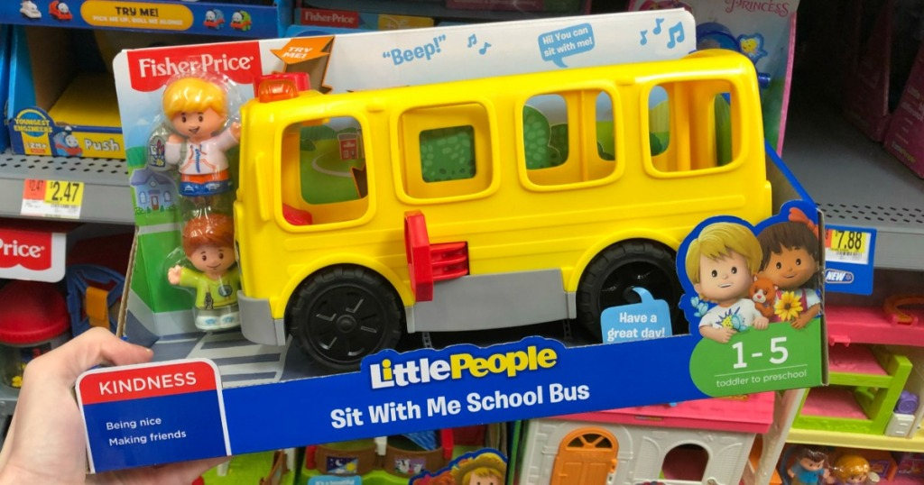 hand holding Little People bus