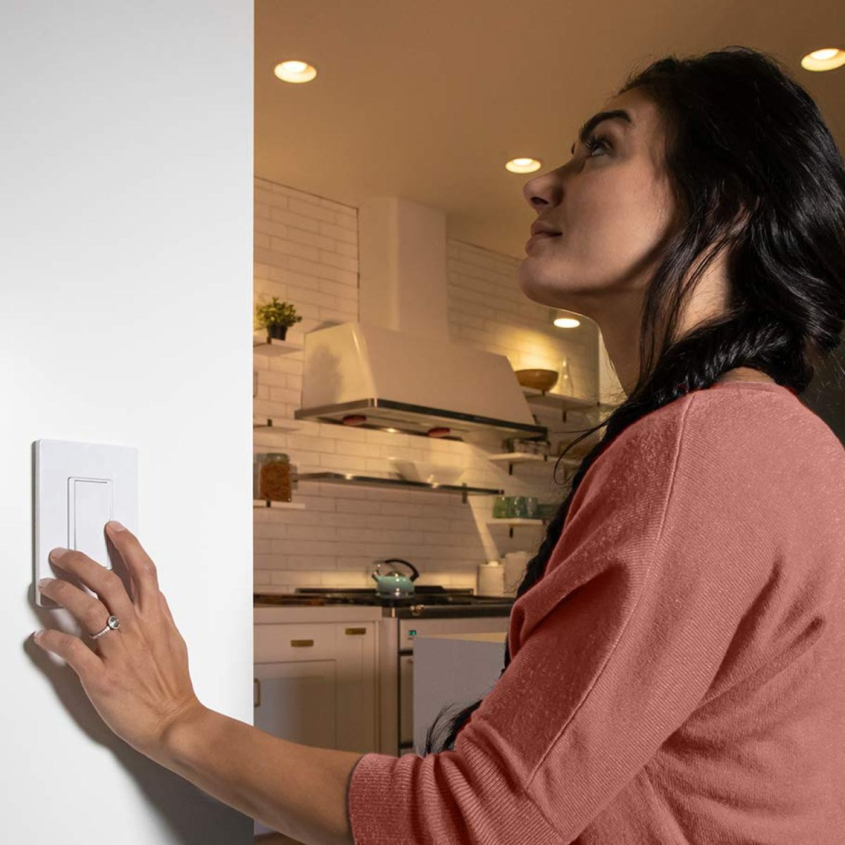 woman turning on light with switch