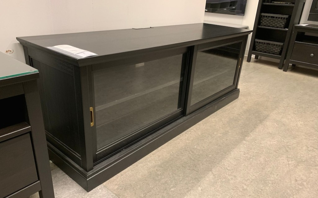 navy blue tv stand with glass doors in ikea store
