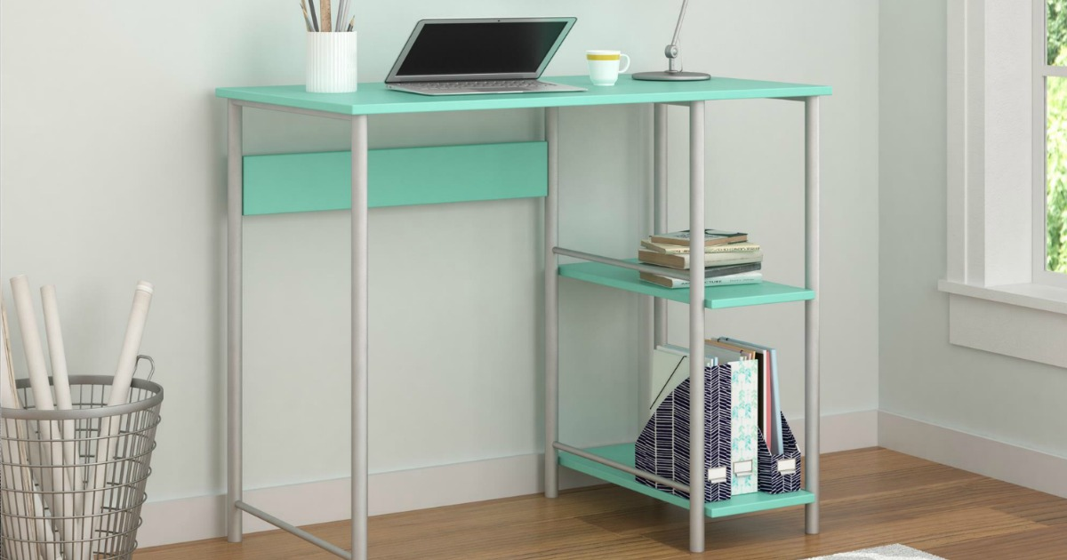 mint colored student's desk with Chromebook and desk lamp on top and books on storage shelf