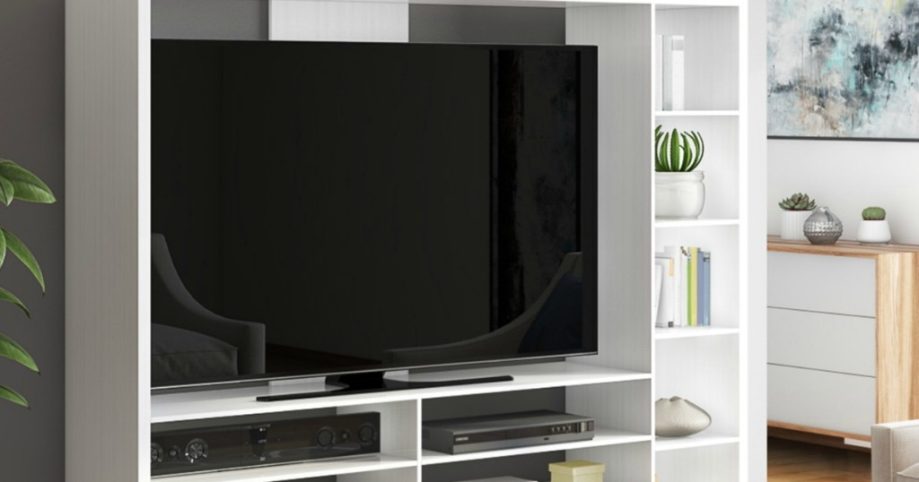 White entertainment stand with large television in living room