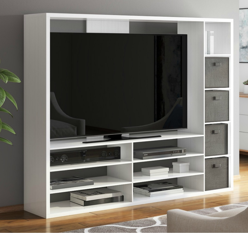 Mainstays brand entertainment stand in living room with gray fabric bins