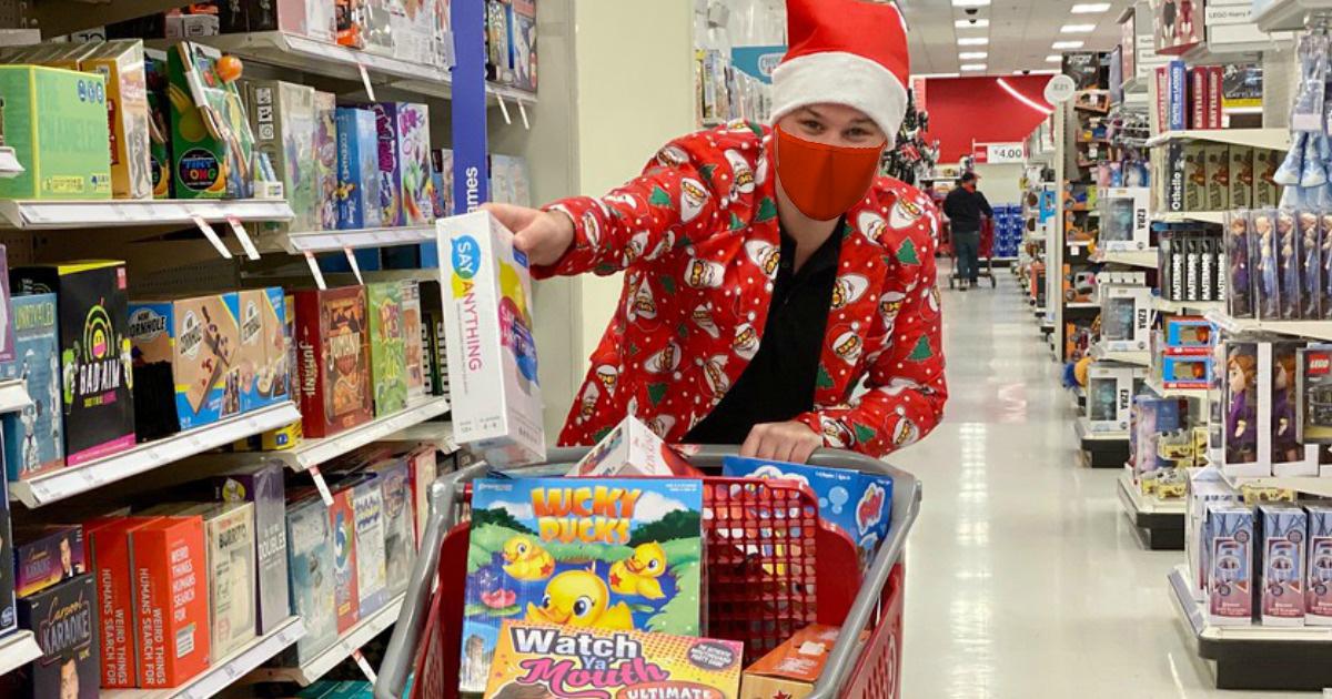 Man wearing santa print suit shopping for Christmas at Target