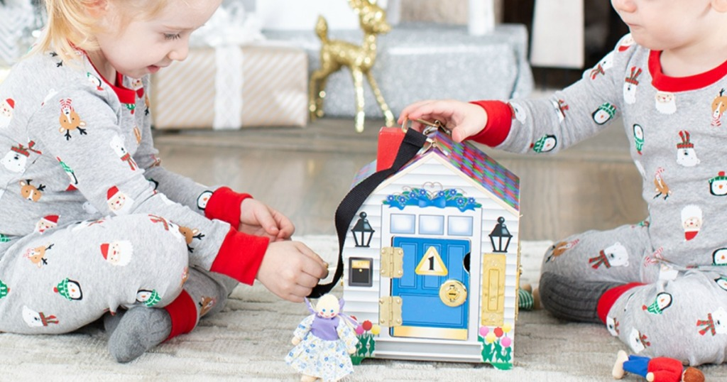 kids playing with dollhouse