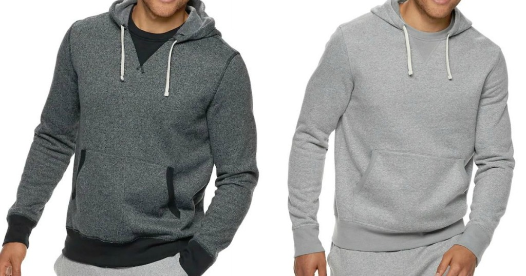 two men in sweatshirts and pants on white background