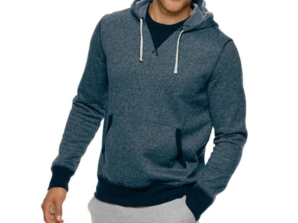 man wearing hoodie with hand in pocket