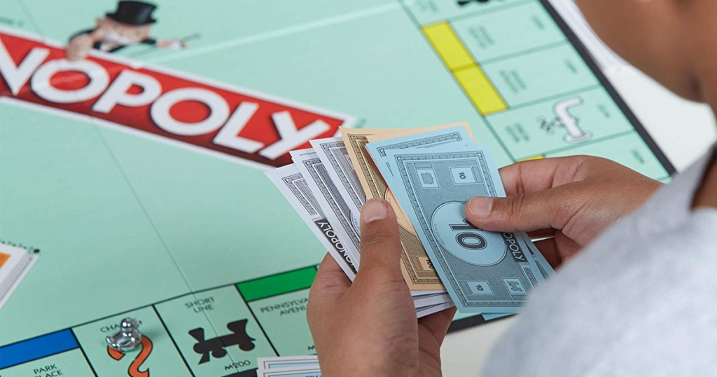 kid playing monopoly