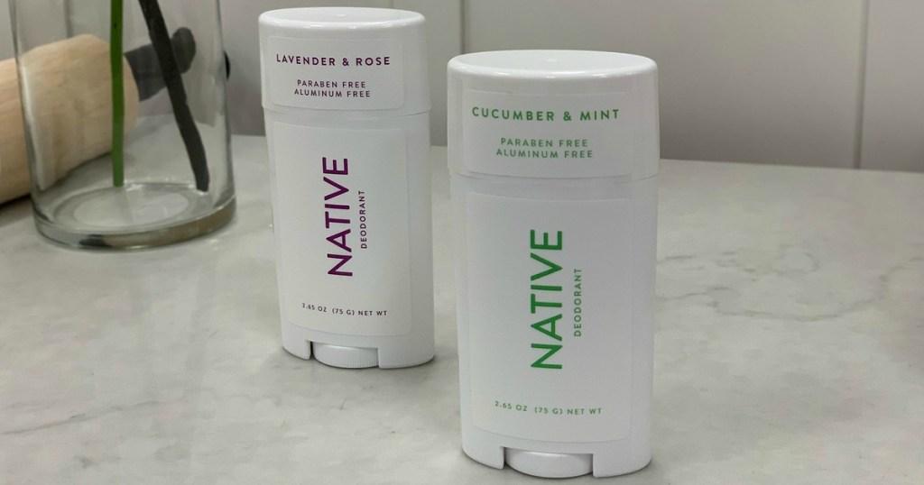 two sticks of women's deodorant on bathroom counter