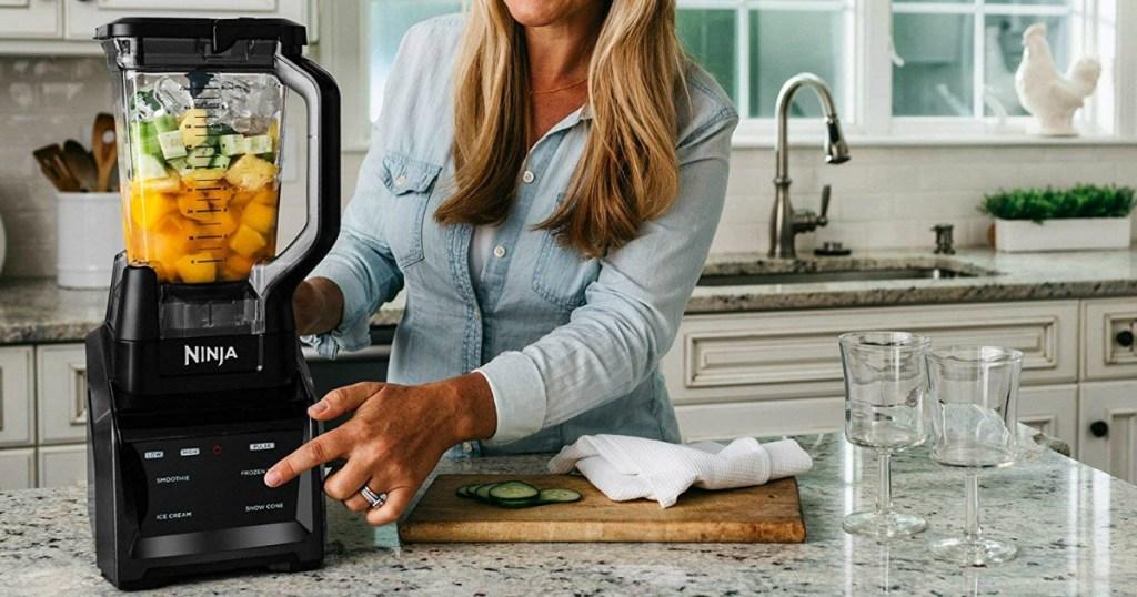 Ninja Blender Kitchen System filled with smoothie ingredients