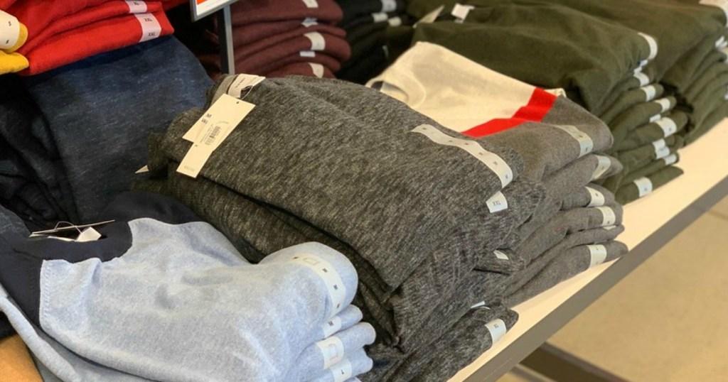 Old Navy men's sweatshirts on table