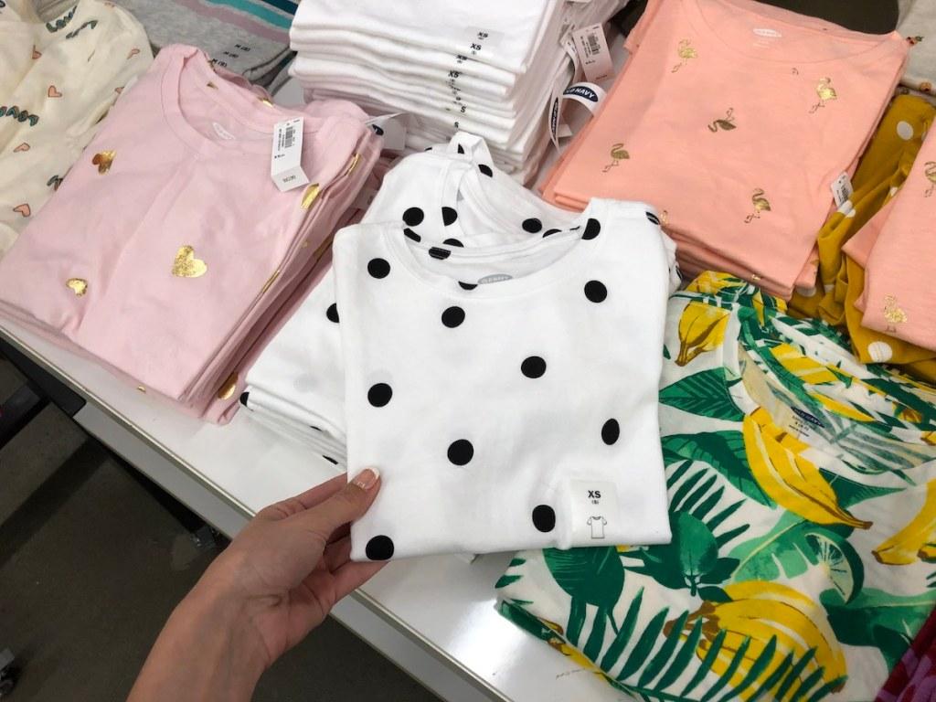 hand holding girl's shirt