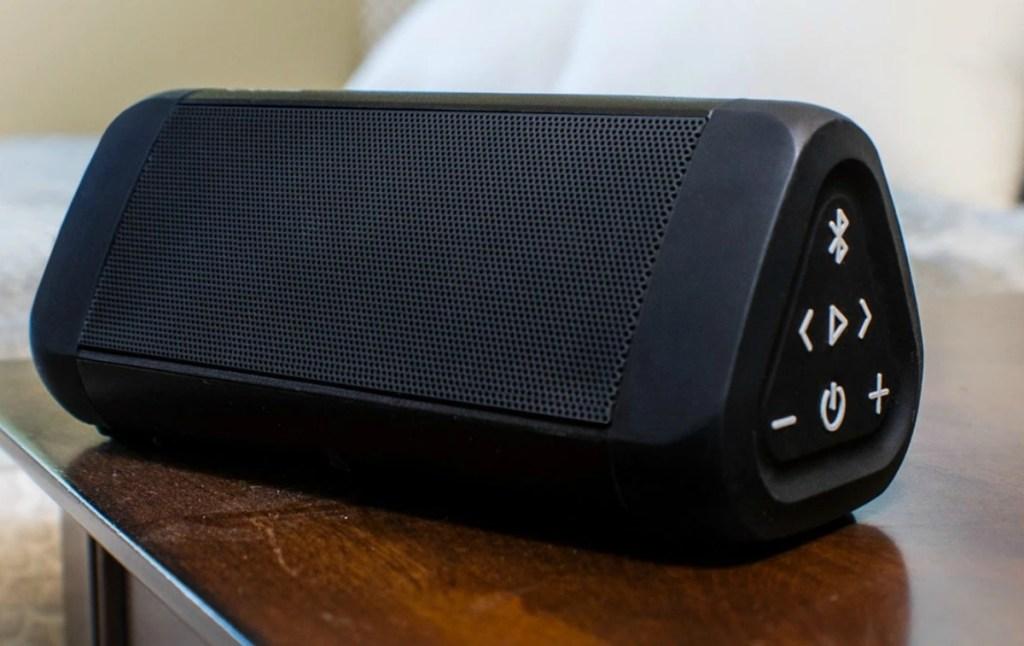 OontZ brand portable speaker on bedroom endtable